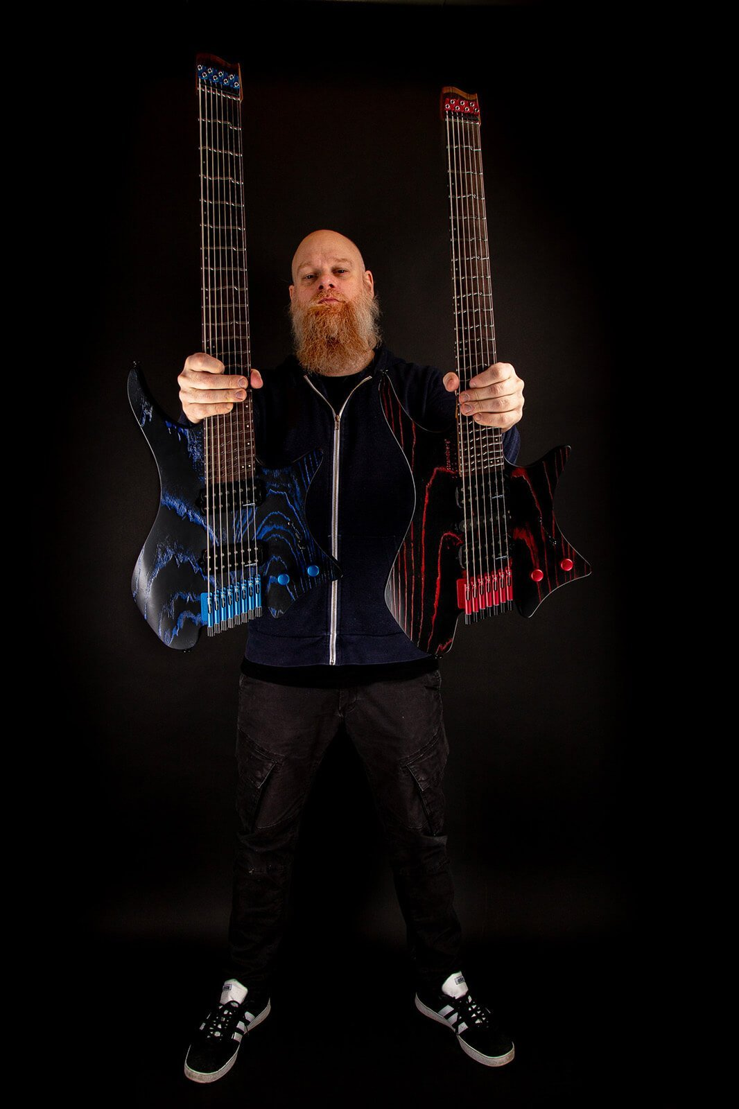 Per Nilsson holding Headless Guitar Boden Singularity