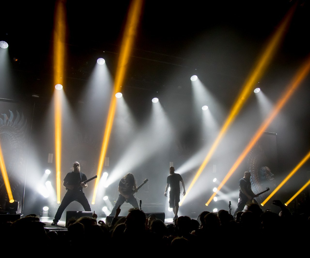Per Nilson on stage with meshuggah band signatuer headless guitar