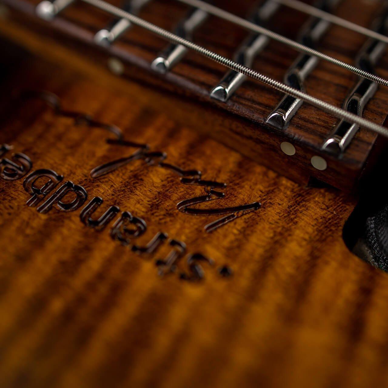 True Temperament Brown Burst 6 string headless guitar closeup logotype Strandberg Boden