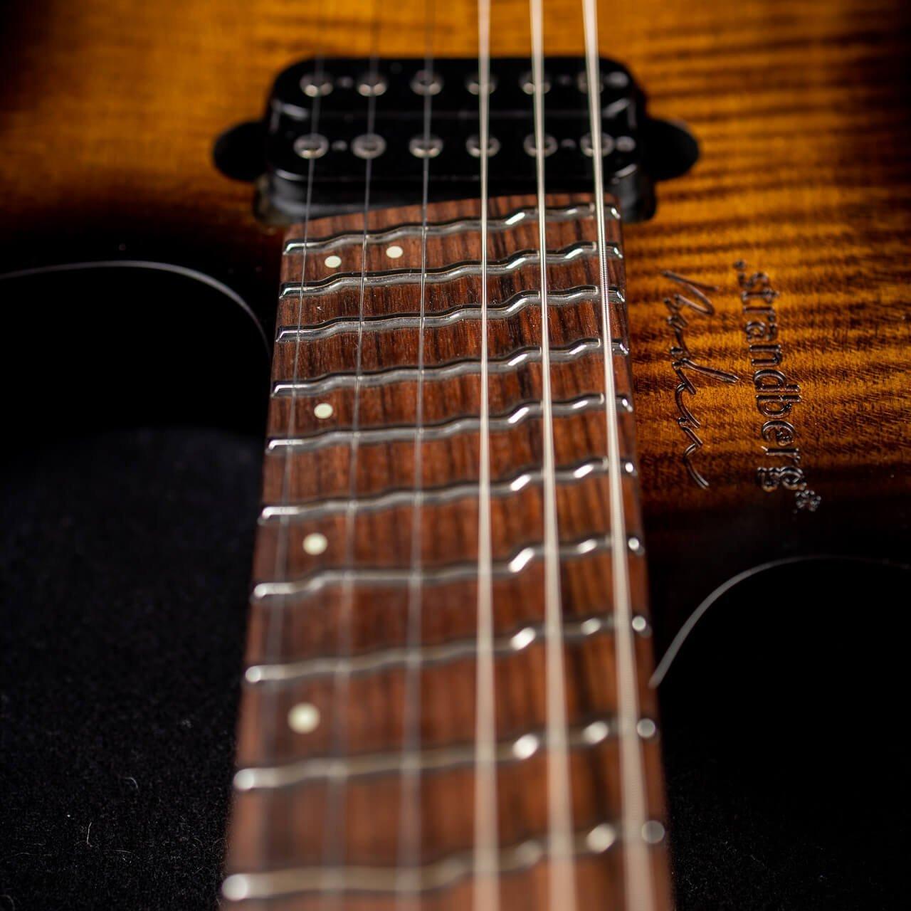 True Temperament brown burst 6 string headless guitar fretboard