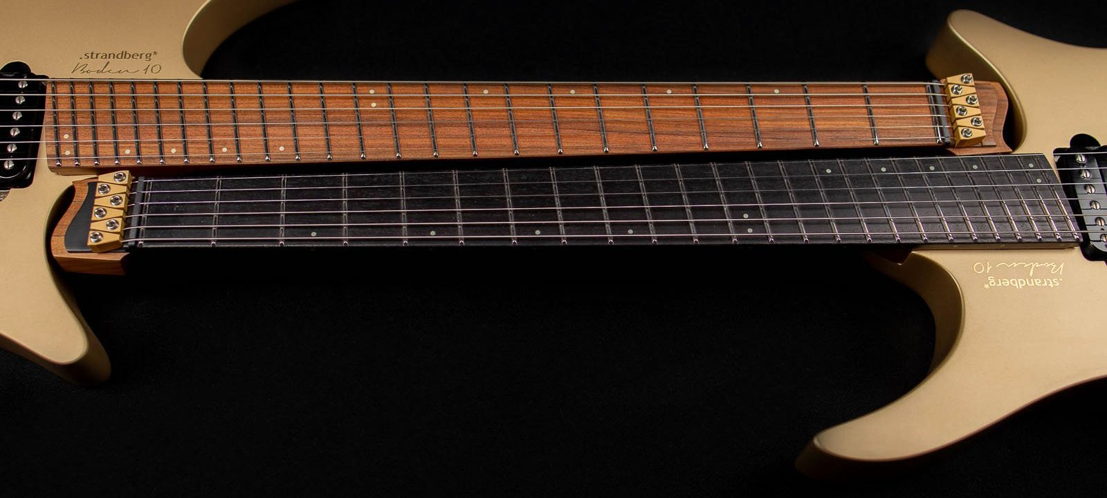 10 year anniversary 6 string gold headless guitar front view