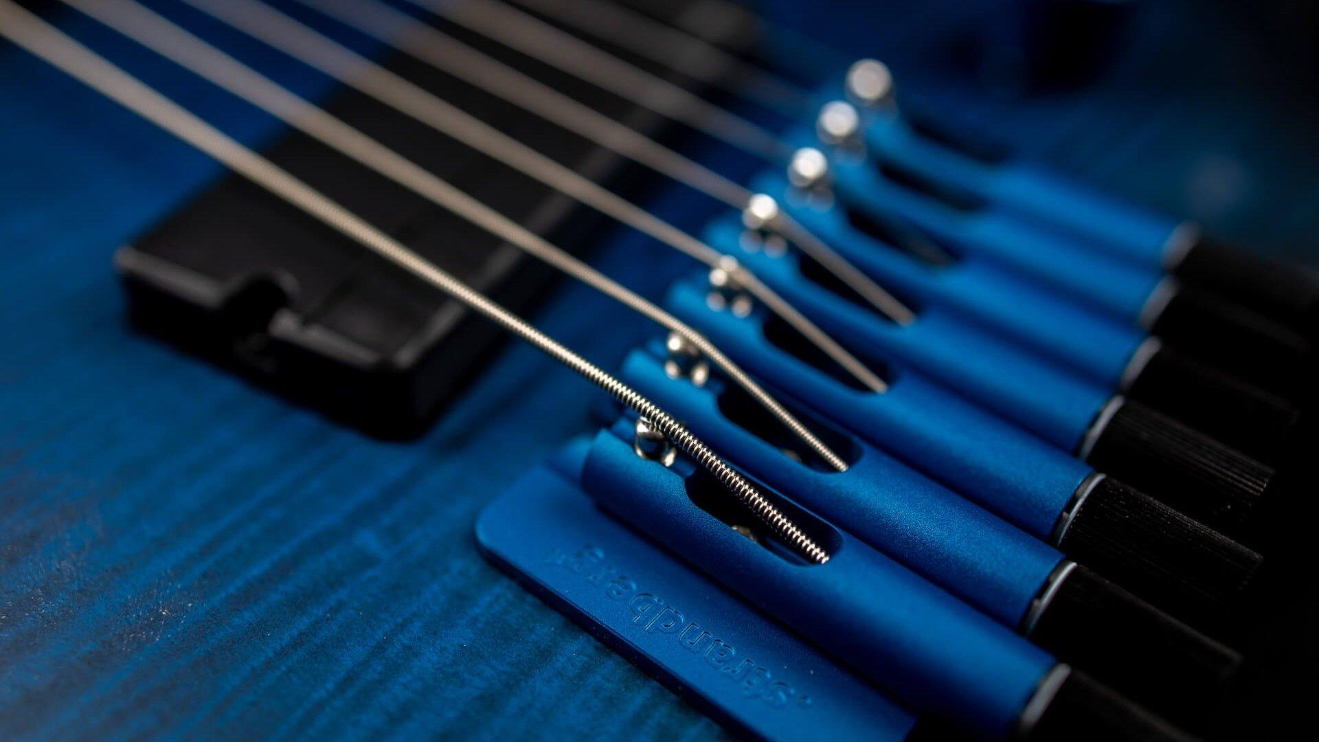 True Temperament Blue 7 string headless guitar closeup strings