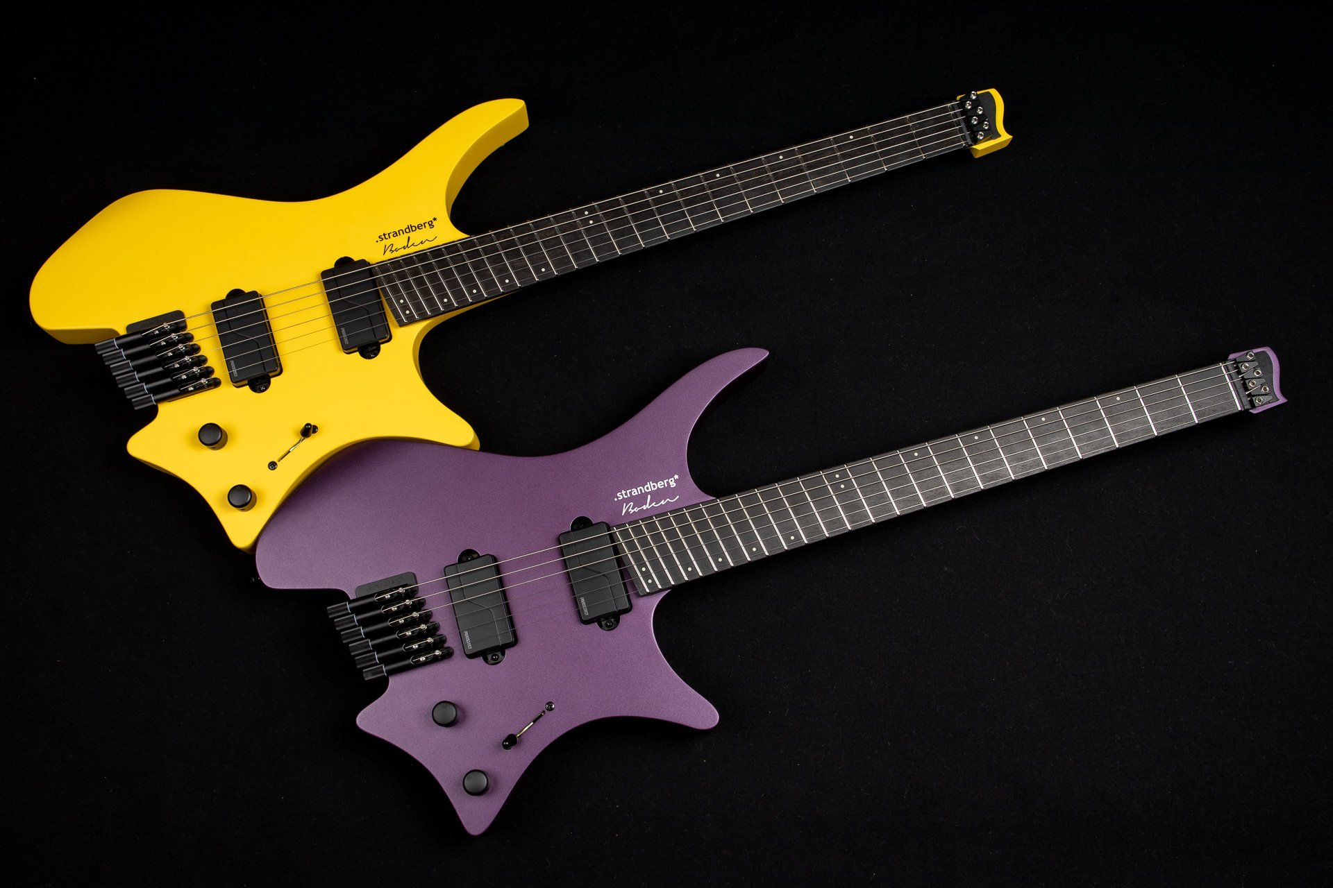 Headless Guitar Boden Metal purple and yellow front view side by side