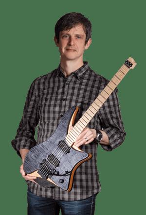 Ola Strandberg holding Headless guitar