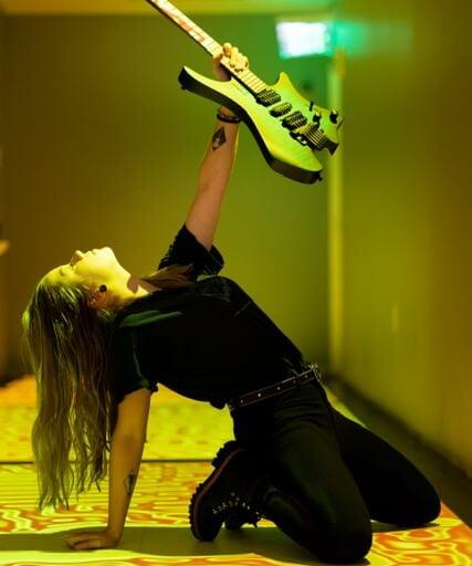 Erin Coburn Holding strandberg headless guitar towards light