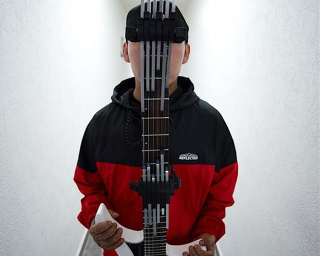 Jose macario holding a strandberg headless guitar