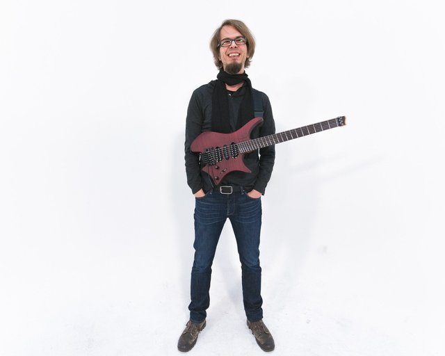 Alex Machacek with headless strandberg guitar