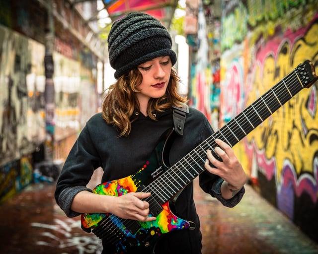 Sara Longfield playing her signature headless guitar