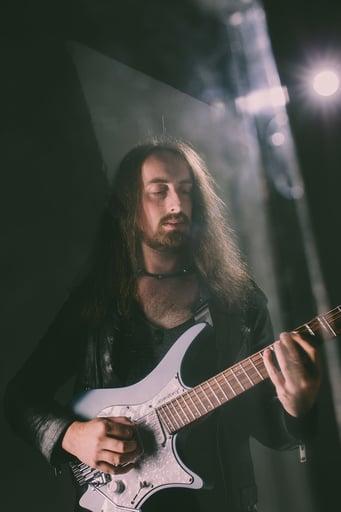 Jack gardiner playing his Classic 6 string malta blue headless guitar