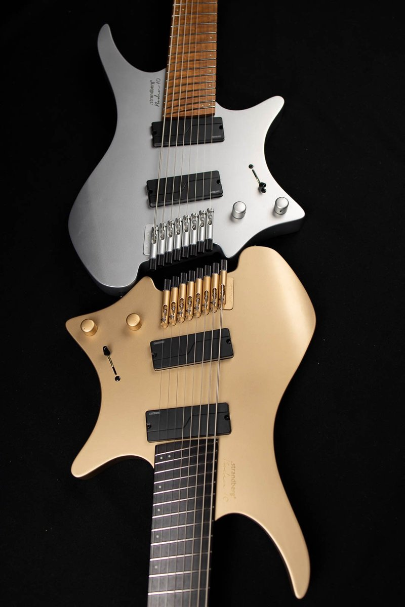 10 year anniversary boden headless guitars 8 string silver and gold front view