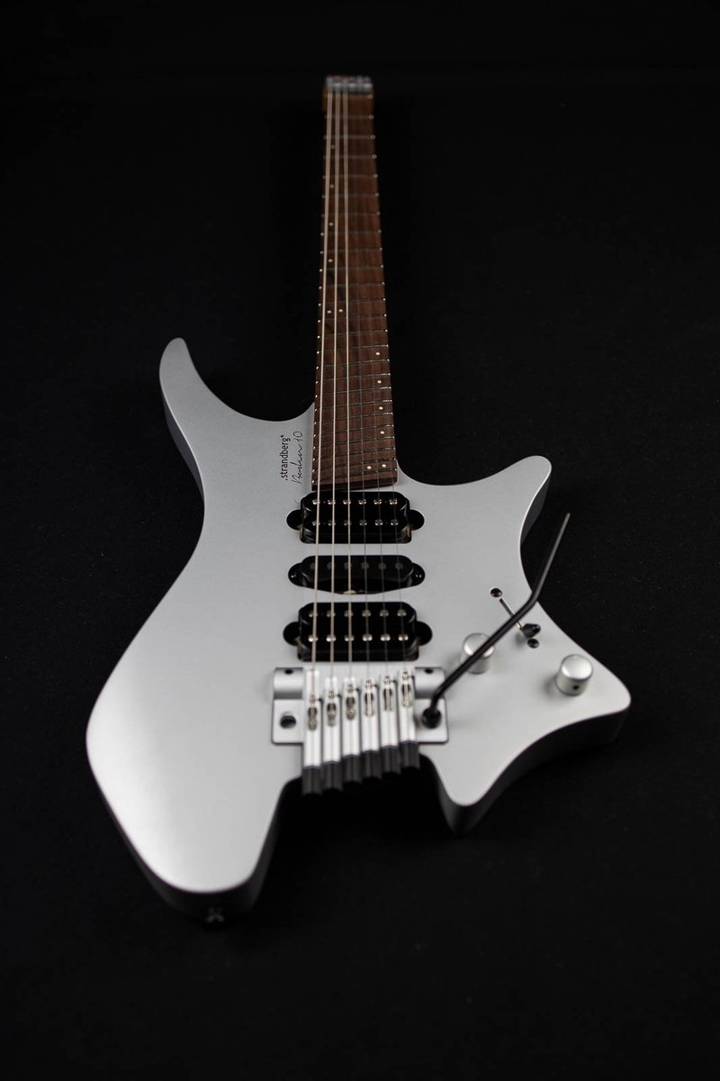 10 year anniversary boden headless guitars 6 string silver front view