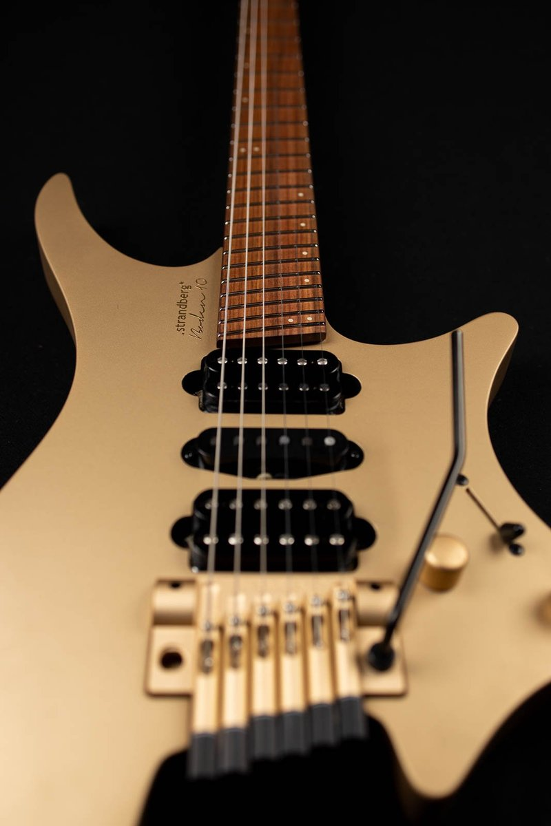 10 year anniversary boden headless guitars 6 string gold front view