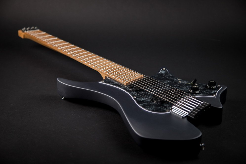 Headless Boden Graphite Classic 7 featuring a black pearloid pickguard and roasted maple fretboard.