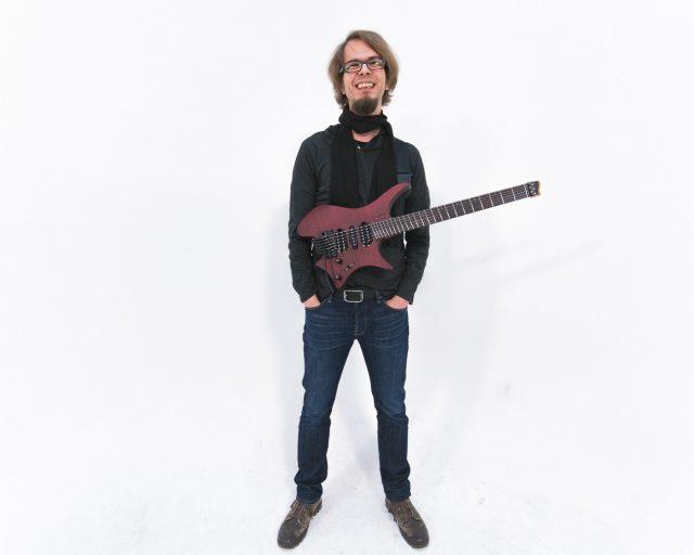 Alex Machacek with headless strandberg guitar