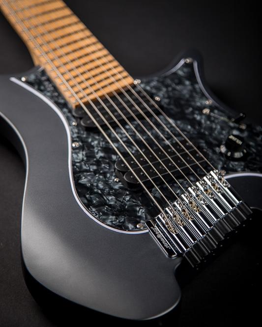Headless Boden Graphite Classic 8 featuring a black pearloid pickguard and roasted maple fretboard.