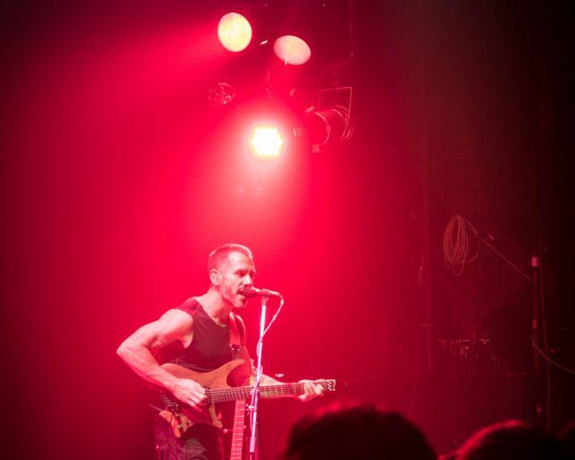 Paul Masvidal on stage with headless strandberg guitar
