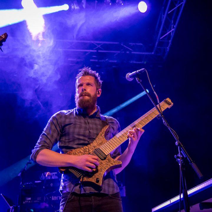 Richard Henshall on stage with strandberg headless guitar