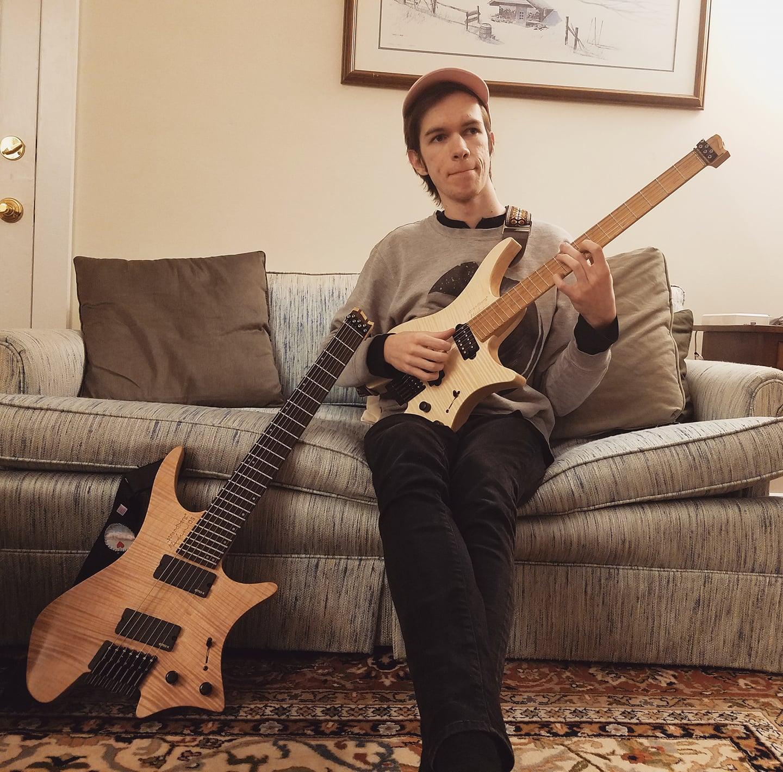 Brock Benzel playing a headless strandberg guitar