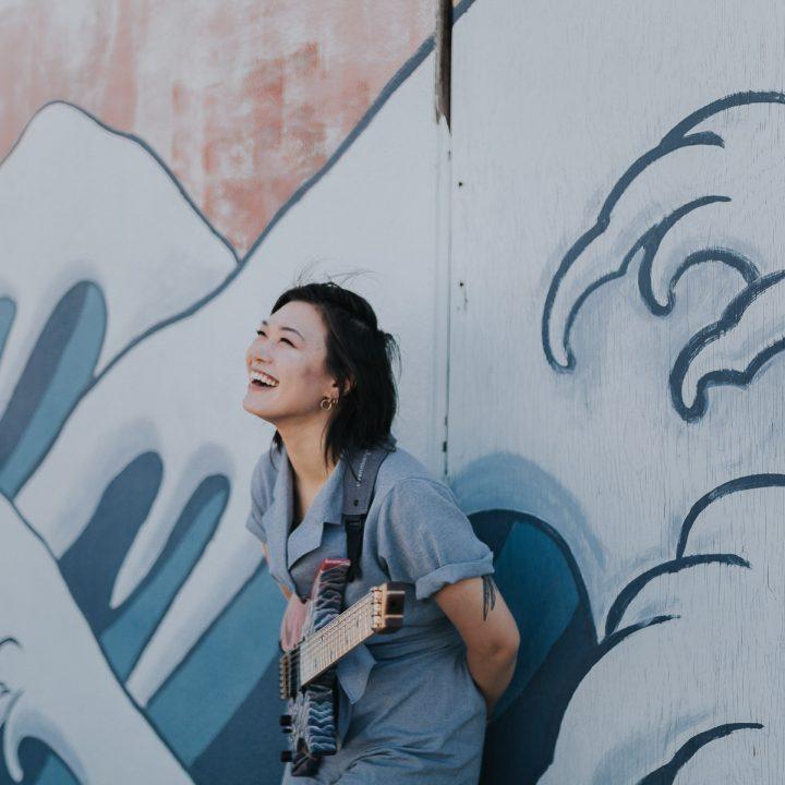 Yvette Young holding her strandberg headless guitar