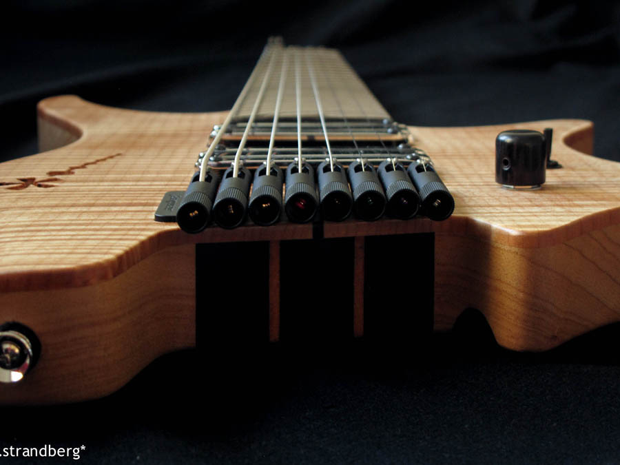 Headless guitar 8 string closeup