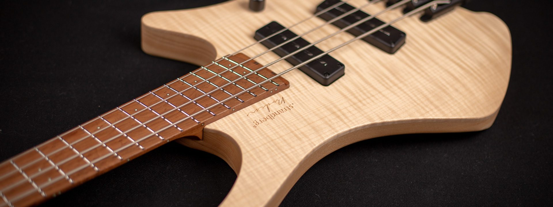 Headless Boden Bass 4-string natural front view