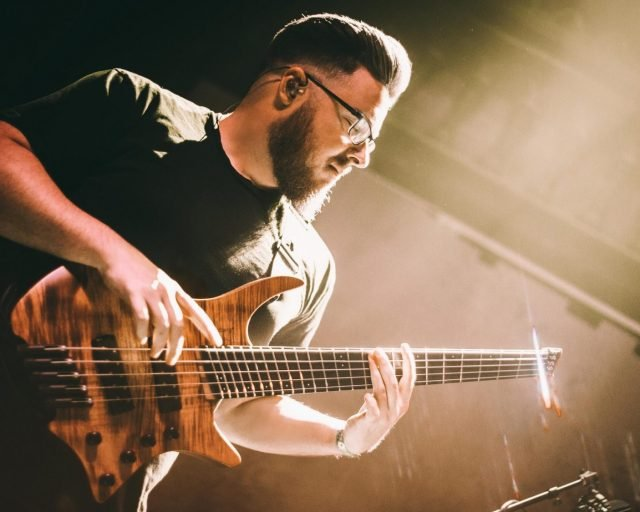 Simon grove with Boden headless guitar on stage