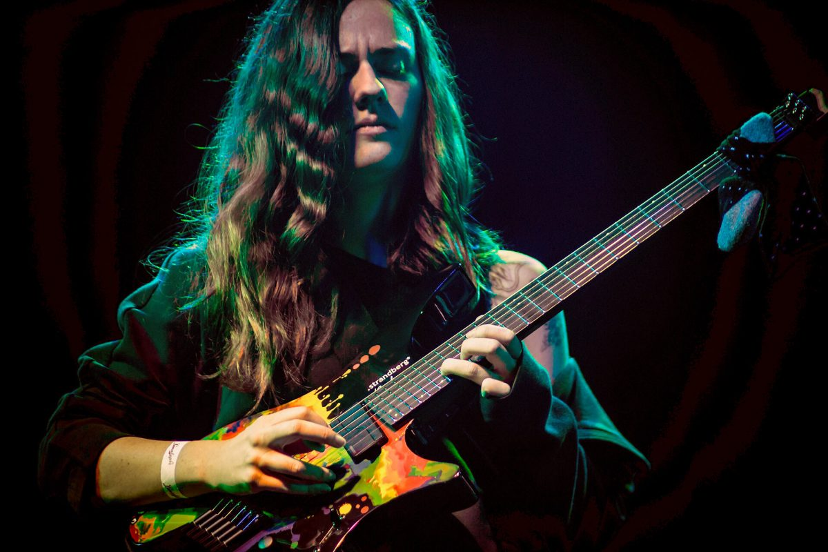 Sara Longfield on stage with her signature headless guitar