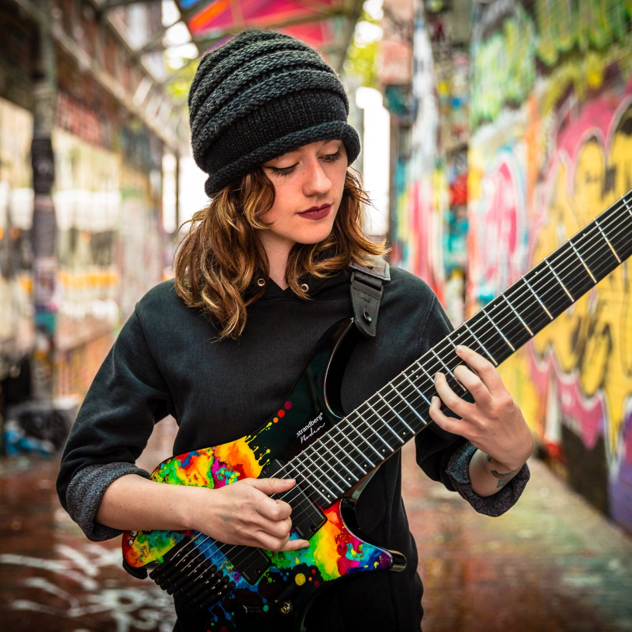 Sara Longfield playing her signature headless guitar