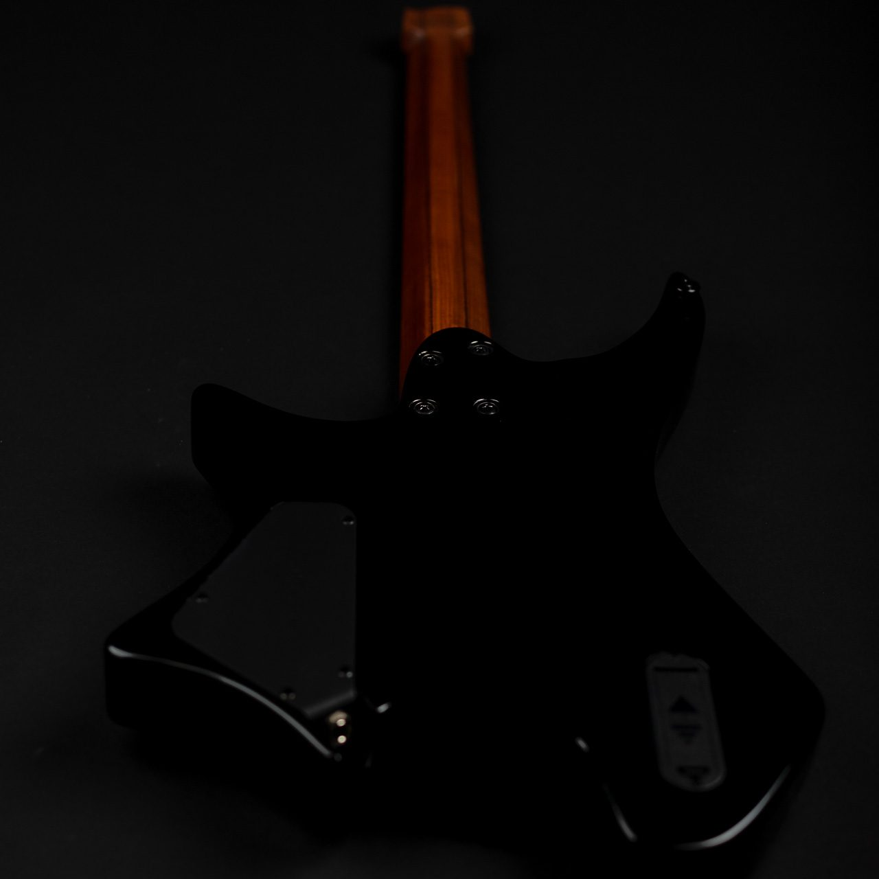 Sara Longfield 7 string headless guitar back view