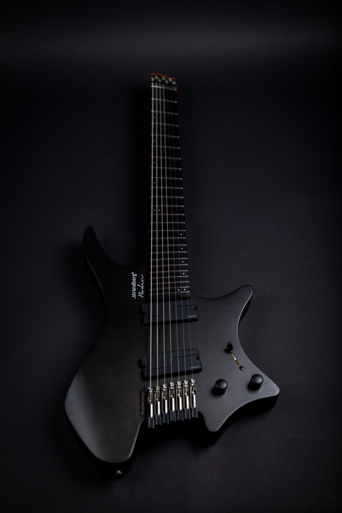 Headless guitar boden metal black 7 string front view