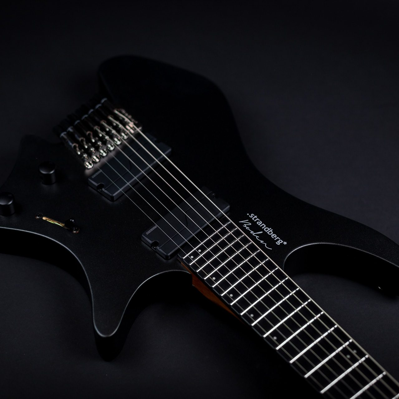 Headless guitar boden metal black 8 string front view