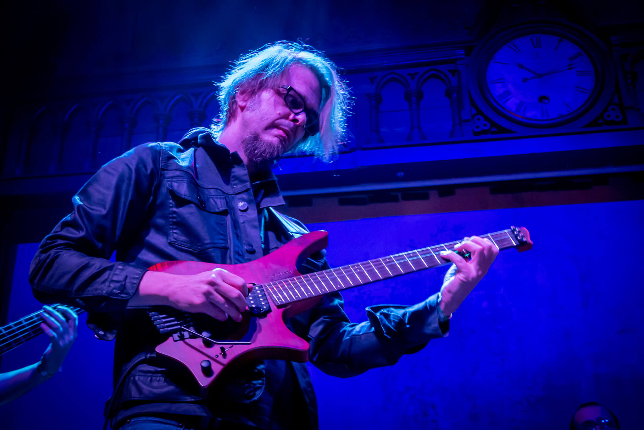 Alex machaeck on stage with his signature headless guitar