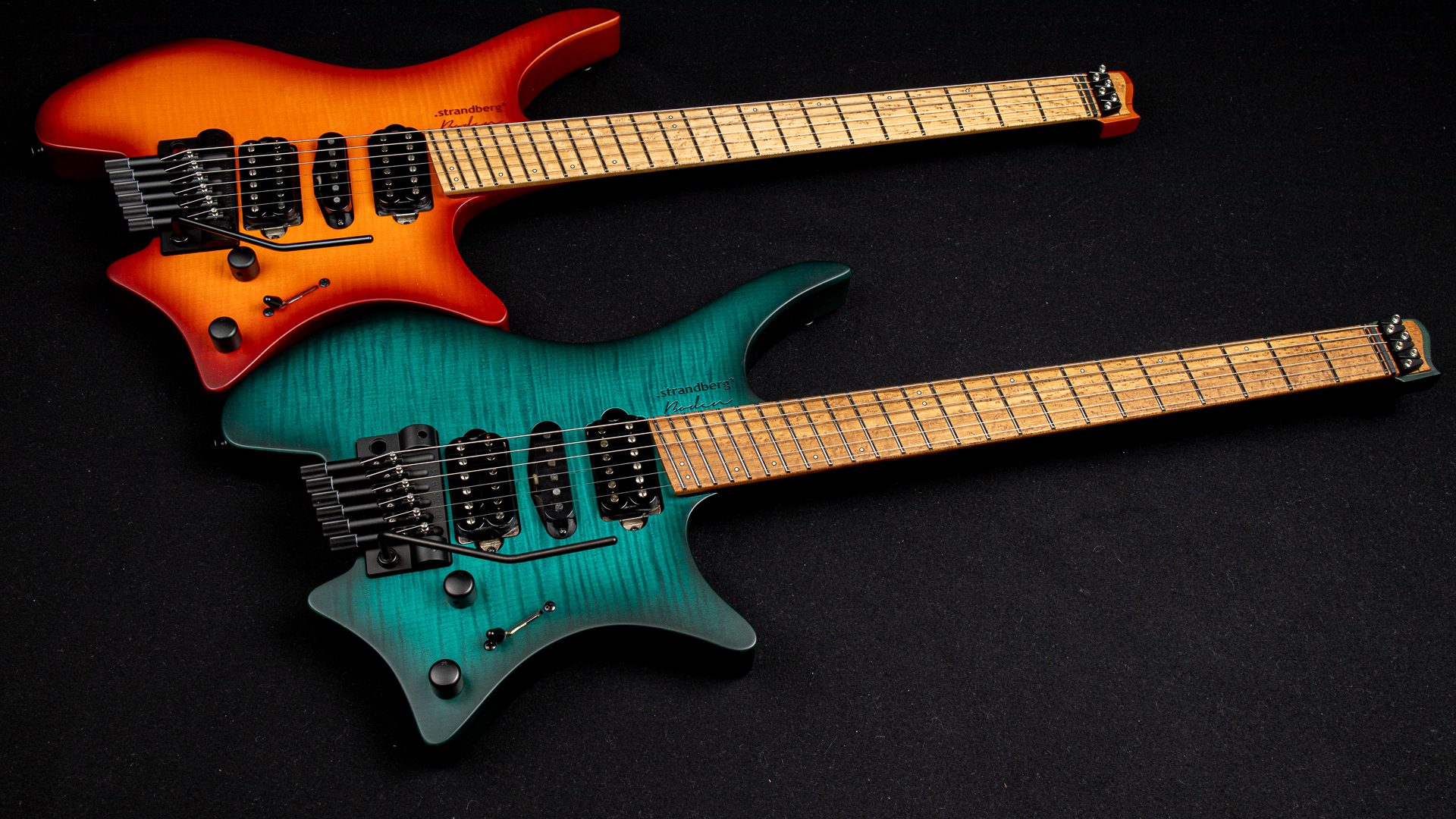 Boden Neck Through headless guitars orange and trans teal side by side