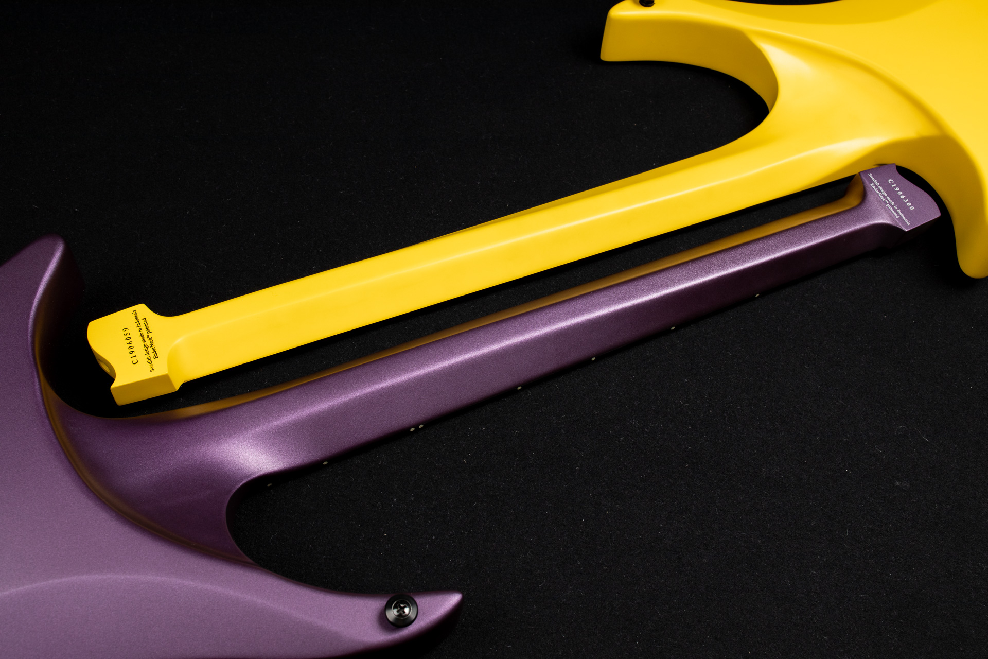 Headless Guitar Boden Metal purple and yellow closeup neck