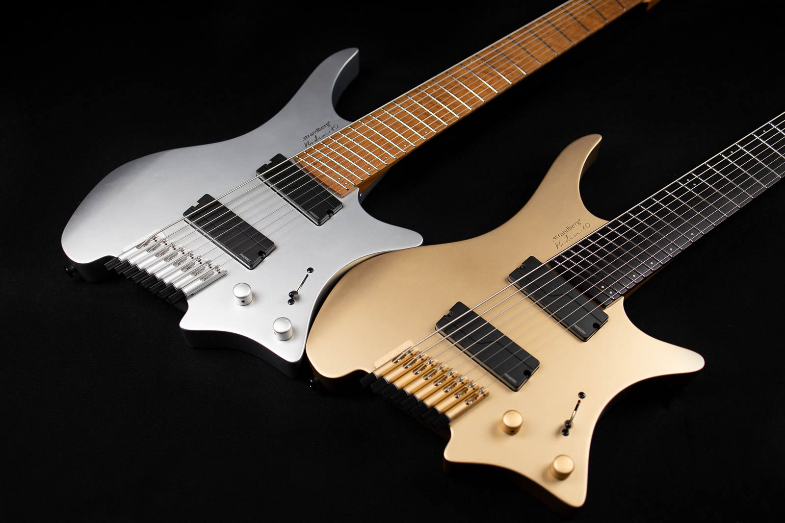 10 year anniversary boden headless guitars multi scale silver and gold front view